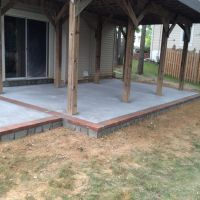 Concrete Patio with Stone Face and Brick Borders in Dale City, VA - Wright's Concrete