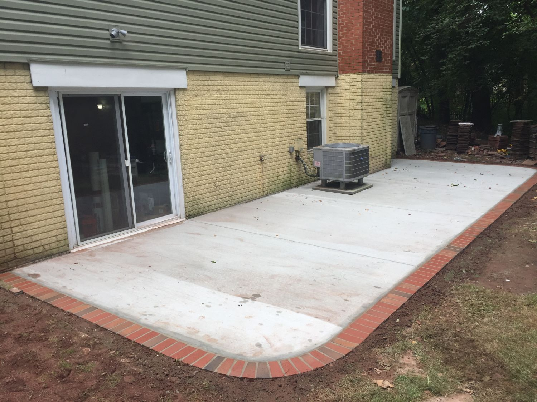 Concrete Patio With Brick Borders In
