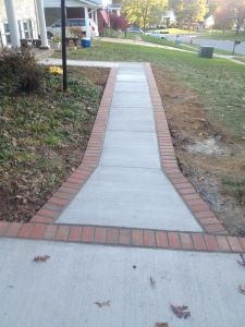 Concrete Driveway and Brick Lined Path in Reston, VA - Wright's Concrete