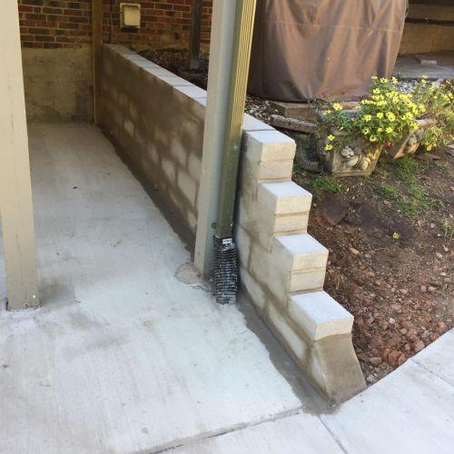 Concrete Driveway, Sidewalk, Concrete Patio with Brick Borders, Retaining Wall in Springfield VA - Wright's Concrete