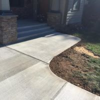 Concrete Driveway, Sidewalk, Concrete Patio with Brick Borders, Retaining Wall in Springfield VA - Wright's Concrete